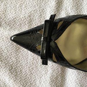 Black patent leather sling backs